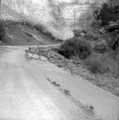 File-Flood damage on park road near utility area; cloudburst at 6-30 p.m. leading to 1.08-inches of rain. -One of two images on (c204c8ddaa2b40089914b4e33815987b).tif