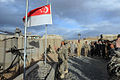 Flag lowering by Singapore troops, Kiwi Base, Bamyan Province, Afghanistan - 20101027.jpg