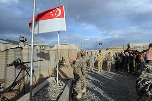 Flag lowering by Singapore troops, Kiwi Base, Bamyan Province, Afghanistan - 20101027