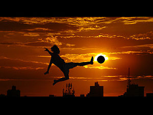 English: Flying soccer kick