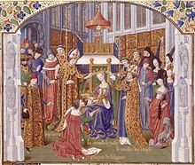 A crowned woman who sits on a throne puts a crown on the head of a man who kneels before her; they are surrounded by two bishops, other clerics and secular lords and ladies