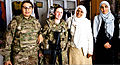 From left, Aziza, an Afghan interpreter, and U.S. Army Sgt. Ashley Rohr, female engagement team member with 1st Battalion, 125th Infantry Regiment, 37th Infantry Brigade Combat Team, Michigan Army National 120308-A-ZZ999-003.jpg