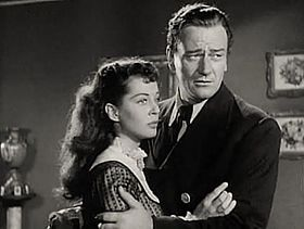 Gail Russell-John Wayne in Wake of the Red Witch trailer.jpg