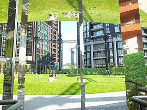 Gas holder - A mirrored installation in the re-located King's Cross Gas Holder Number 8., London.