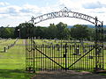 Gate to Saint Stanislaus Roman Catholic Cemetery in Meriden, Connecticut.jpg