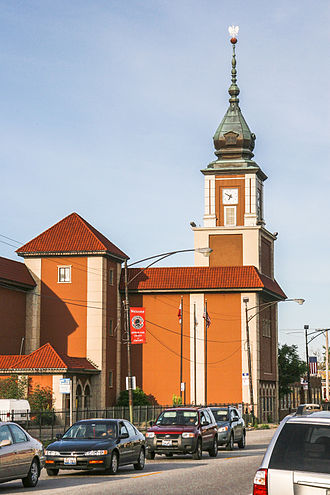 Polish Americans - The Gateway Theatre, seat of the Copernicus Foundation, in Jefferson Park, Chicago. The Baroque spire is modeled on the Royal Castle, Warsaw.