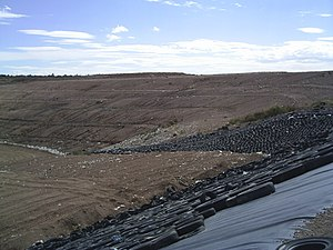 Landfill liner - A landfill in México showing geomembrane in one of the slopes.