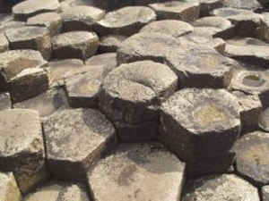Basalt - Large masses must cool slowly to form a polygonal joint pattern, as here at the Giant's Causeway in Northern Ireland