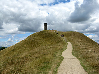 Glastonbury Tor - The last few yards of the walk up the Tor. The concrete path encourages visitors to avoid the steeper, more direct, routes, and thus minimises the possibility of erosion.