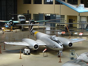 Museo Nacional de Aeronáutica de Argentina - Main hall, with Gloster Meteor (foreground), Huanquero (background) and Urubu (hanging from roof)