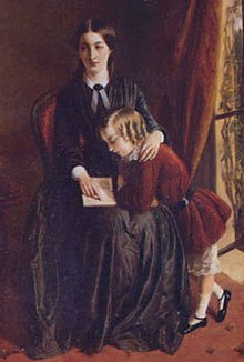 Portrait of a governess, wearing a black dress, seated on a red chair. She is teaching a child with blonde curls and a red velvet dress to read. The child is standing up, leaning into her lap to see the book she is pointing to.