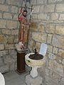 Grèzes (24) église statue et bénitier.JPG