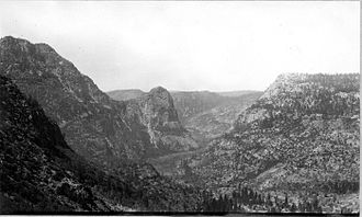 Grand Canyon of the Tuolumne - Down the Grand Canyon of the Tuolumne River and Hetch Hetchy Valley in the distance. Kolana Rock in the center.