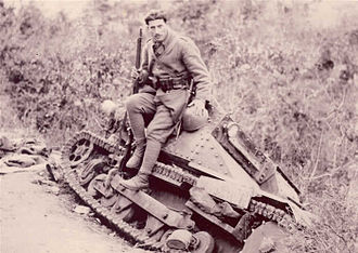 Battle of Elaia–Kalamas - Greek soldier sitting on a captured Italian L3/35 tankette.