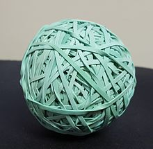 A rubber band ball made of over 300 rubber bands.