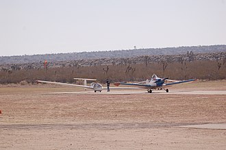 Crystal Airport (California) - A Piper PA-25 Pawnee prepares to tow a Grob 103 Twin Astir at Crystal Airport.