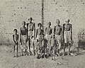 Group of men and children suffering from famine in India.jpg
