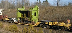 Flatcar - A heavy duty flatcar with load in Ontario in 2004