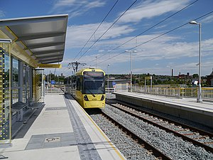 Hollinwood tram stop - Tram pulling into Hollinwood