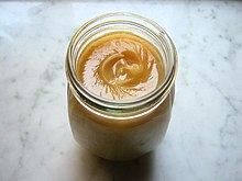 Honey (Italian-miele) in a jar.jpg