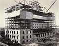 Hotal Sask under construction with bricks from demolished Qu'Appelle.jpg