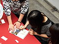 Hou Xuan Signing for Fan 20120429.jpg