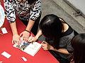 Hou Xuan Signing for Fan 20120429.jpg