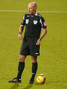 The referee officiates in a football match 927cb6b1d6f81
