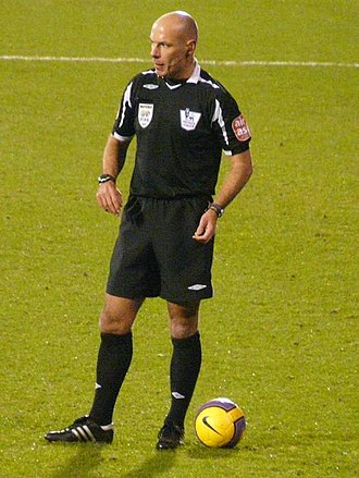 Kit (association football) - Referee Howard Webb wearing a black strip