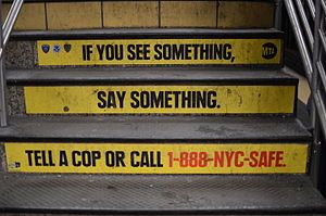 "Metropolitan Transportation Authority - Stairs in the Times Square–42nd Street station painted with the slogan, ""If you see something, say something."""