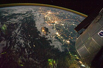 Indo-Gangetic Plain - Clusters of yellow lights on the Indo-Gangetic Plain reveal numerous cities large and small in this astronaut photograph of northern India and northern Pakistan, seen from the northwest. The orange line is the India–Pakistan border.