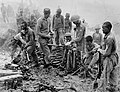 Indian and Gurkha soldiers inspect captured Japanese ordnance during the Imphal-Kohima battle, 1944.jpg