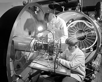 Deep Space 1 - Image: Ion Engine Being Installed in High Vacuum Tank GPN 2000 000597