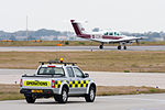 Jersey Airport operations vehicle and aircraft.JPG