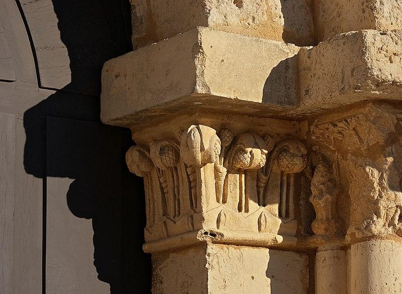 Capital, on the right of the portal of Saint-Gervais-Saint-Protais Church (12th century), Jonzac, Charente-Maritime, France.