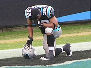 Josh Vaughan - Vaughan praying before a home game at Bank of America Stadium.