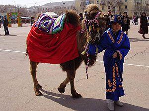 Kazakh boy with a camel in Baikonur