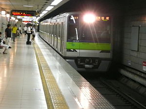 Keiō New Line - A Toei 10-300 series train at Hatsudai Station in August 2013
