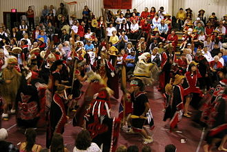 Culture of the Tlingit - A large group dancing at a totem pole raising celebration in Klawock, Alaska, 2005