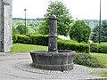 La Courtine fontaine à côté église.jpg