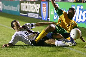 Landon Donovan of the United States clashes wi...