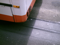 Lane grooves behind bus.png