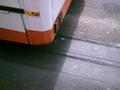 Lane grooves behind bus.png