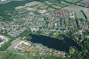 Langen, Cuxhaven - Langen with the flooded gravel pit Baggerkuhle I (Aerial view 2012)
