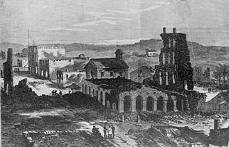 Lawrence massacre - Lawrence in ruins as illustrated in Harper's Weekly. The charred remains of the Eldridge House are in the foreground.