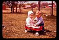 Little kids playing with a red wagon.jpg
