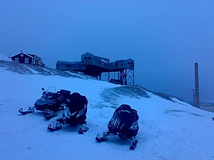 Transport in Svalbard - Snowmobiles at Longyearbyen; abandoned mine shaft in the background