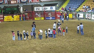 Cowtown Coliseum - As is customary in rodeos, young children are invited into the arena here at the Fort Worth Championship Rodeo in Cowtown Coliseum.