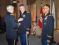 Major Gen. Walsh pins the Legion of Merit medal on Col. Leady (9258428472).jpg