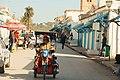 Man riding a three-wheeler in the streets of Testour in Tunisia.jpg